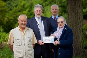 Joan's cousin, Kay Withers pictured with Chairman John Williams and executors Bob (left) and Andrew (right)